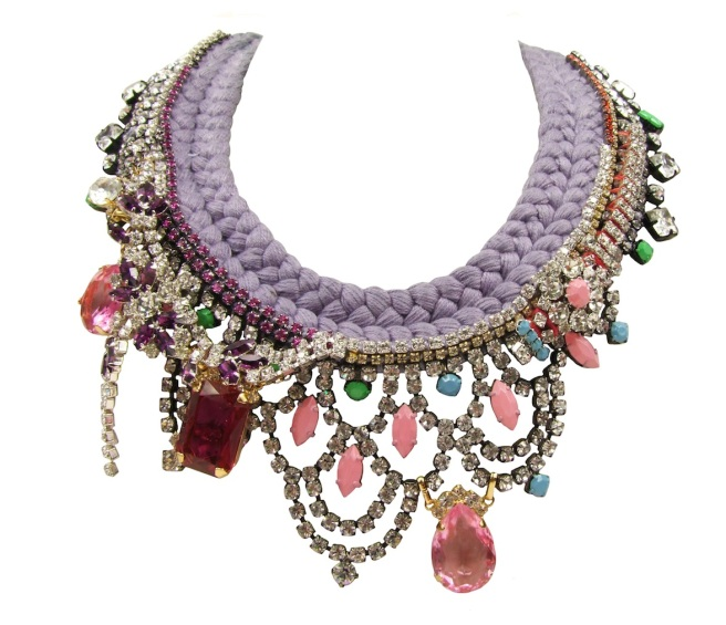 Eccentric is an asymmetric colourful statement necklace by Jolita Jewellery. Made with a double collar lavender silk braid, hand-dyed by the designer in his London studio. Adorned with crystals, some of which are hand-painted in soft pastels.