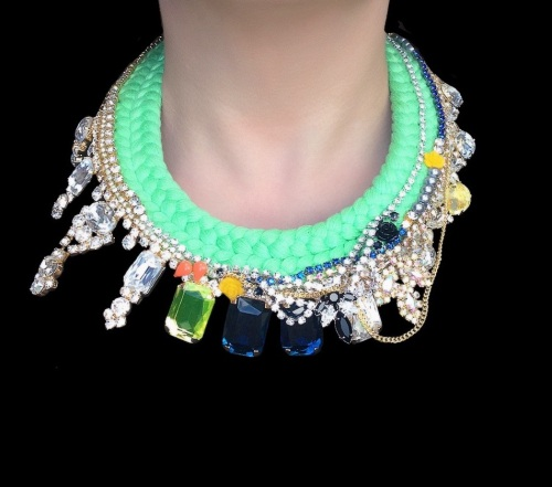 A colourful double collar statement piece by Jolita Jewellery made with clear, blue and yellow crystals, chains and neon Swarovski pearls