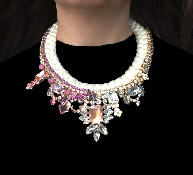 Shanghai At Dusk is a luxury one-of-a-kind statement necklace by Jolita Jewellery. Created with hand-dyed cream silk, which is adorned with an array of dipped in gold clear and pink crystals.