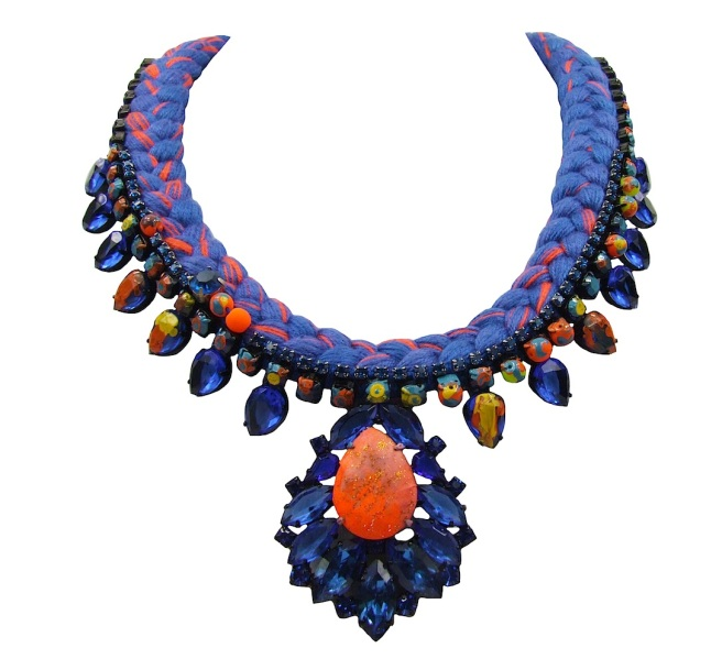 This beautiful Jolita Jewellery handmade statement necklace is made with blue silk braid, mixing in a touch of vibrant orange, hand-dyed by the designer in his London studio. The necklace is embellished with a row of small crystals in blue, colourful neon rhinestones and adorned with a beautiful cobalt blue crystal necklace. Secures at the back with a lobster clasp and a chain.