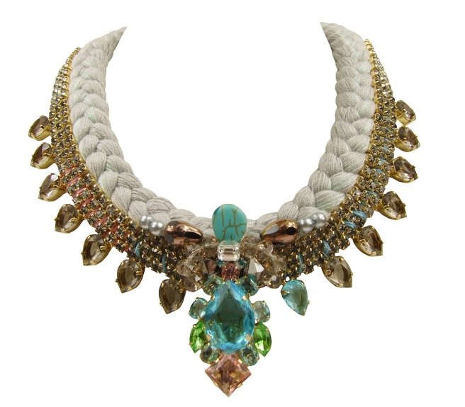 Monte Carlo statement necklace designed by Jolita Jewellery with dipped in gold smokey quartz crystals and soft grey silk braid, hand-dyed by the designer in his London studio. The necklace is adorned with aquamarine, green and pink crystals and semi-precious stones embellishment at the centre.