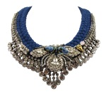 This beautiful Monaco statement necklace by Jolita Jewellery is made with clear crystals and braided double collar rich royal blue silk, hand-dyed by the designer in his London studio. The braid is embellished with chains, Swarovksi crystals, hand-made porcelain skulls and a beaded bug, intricately hand-stitched together.
