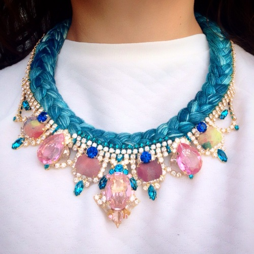 This beautiful hand-made Salzburg statement by Jolita Jewellery is made with hand-dyed silk braid and dipped in gold pink and clear crystals.
