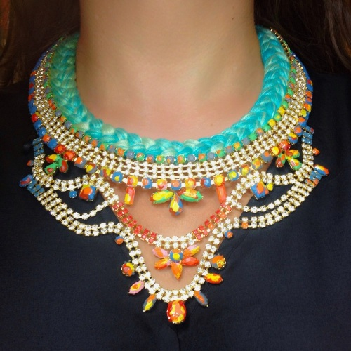 This colourful Alexandria statement necklace by Jolita Jewellery is made with mint green silk braid, mixing in a touch of chartreuse. The braid is embellished with a beautiful crystal necklace, dipped in gold and hand-painted in vibrant colours.