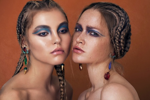 From beauty editorial - Debutante statement earrings in green crystals and Countess statement earrings in blue and red crystals. Both by Jolita Jewellery
