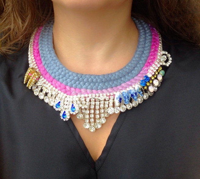 This beautiful Monaco statement necklace by Jolita Jewellery is made with clear crystals and braided triple collar grey and purple-pink silk, hand-dyed by the designer in his London studio. The braid is embellished with spikes, Swarovksi crystals, hand-made porcelain skulls , intricately hand-stitched together.
