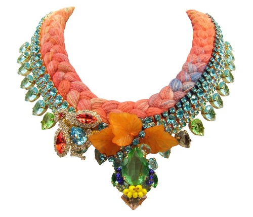 Santorini Luxe statement necklace by Jolita Jewellery, created with vibrant multicoloured hand-dyed silk in orange as a base and adorned with dipped in gold crystals in turquoise and green. The centre of the necklace is embellished with orange leaves and colourful crystal bug