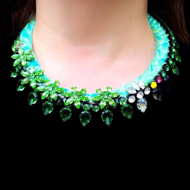 Majorca statement necklace by Jolita Jewellery, created with hand-dyed silk braid in chartreuse green and embellished with greed crystals and green crystal flowers