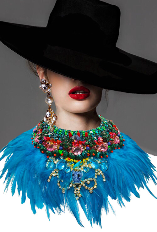 Blue feather statement necklace by Jolita Jewellery, embellished with Swarovski crystals, hand-made porcelain skull and blue feathers