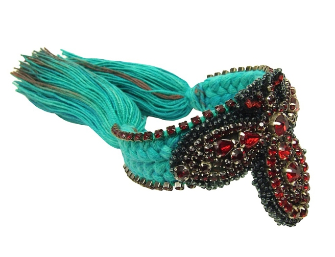 Colourful braided cuff handmade with a turquoise silk braid, hand-dyed in our studio, and embellished with hand-beaded red bug