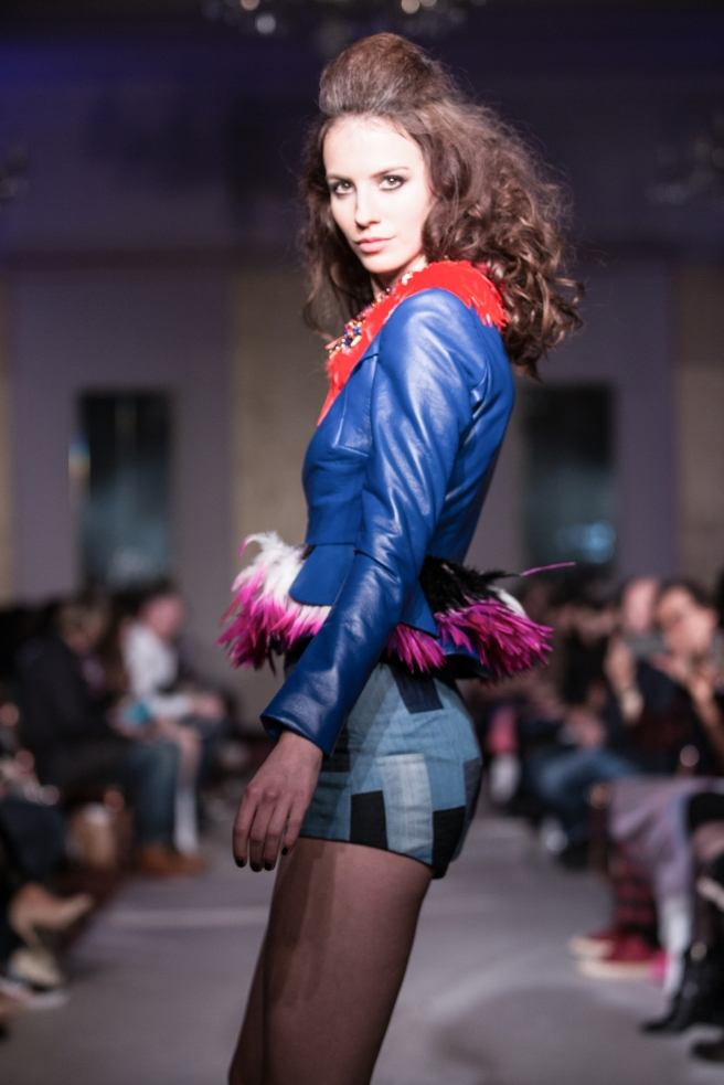 Red Feathers and Swarovski crystal collar by Jolita Jewellery. As seen on the catwalk during London Fashion Week February 2017, accessorising Ethologies's AW17 collection.
